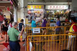 Shoppers welcome enhanced Covid-19 safety measures at Singapore markets, hawker centres