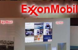 Exxon pays debts as peers revive share buybacks