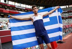 Olympics-Athletics-Greece's Tentoglou wins gold with dramatic final leap