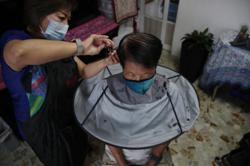 Business brisk for mobile hairdressers in Singapore amid Covid-19
