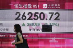 Asian stocks rising but China reports a slowdown in manufacturing activity rise