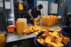 Asia's factories reflect North-South divide as Delta spreads