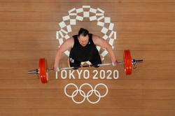 Olympics-Weightlifting-Hubbard makes history as first transgender Olympian, but exits early