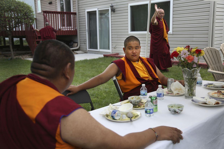 Tibetan Buddhism meditation and mentor Khenpo Kunga, left, talks with 14-year-old Dorje after a dinner.