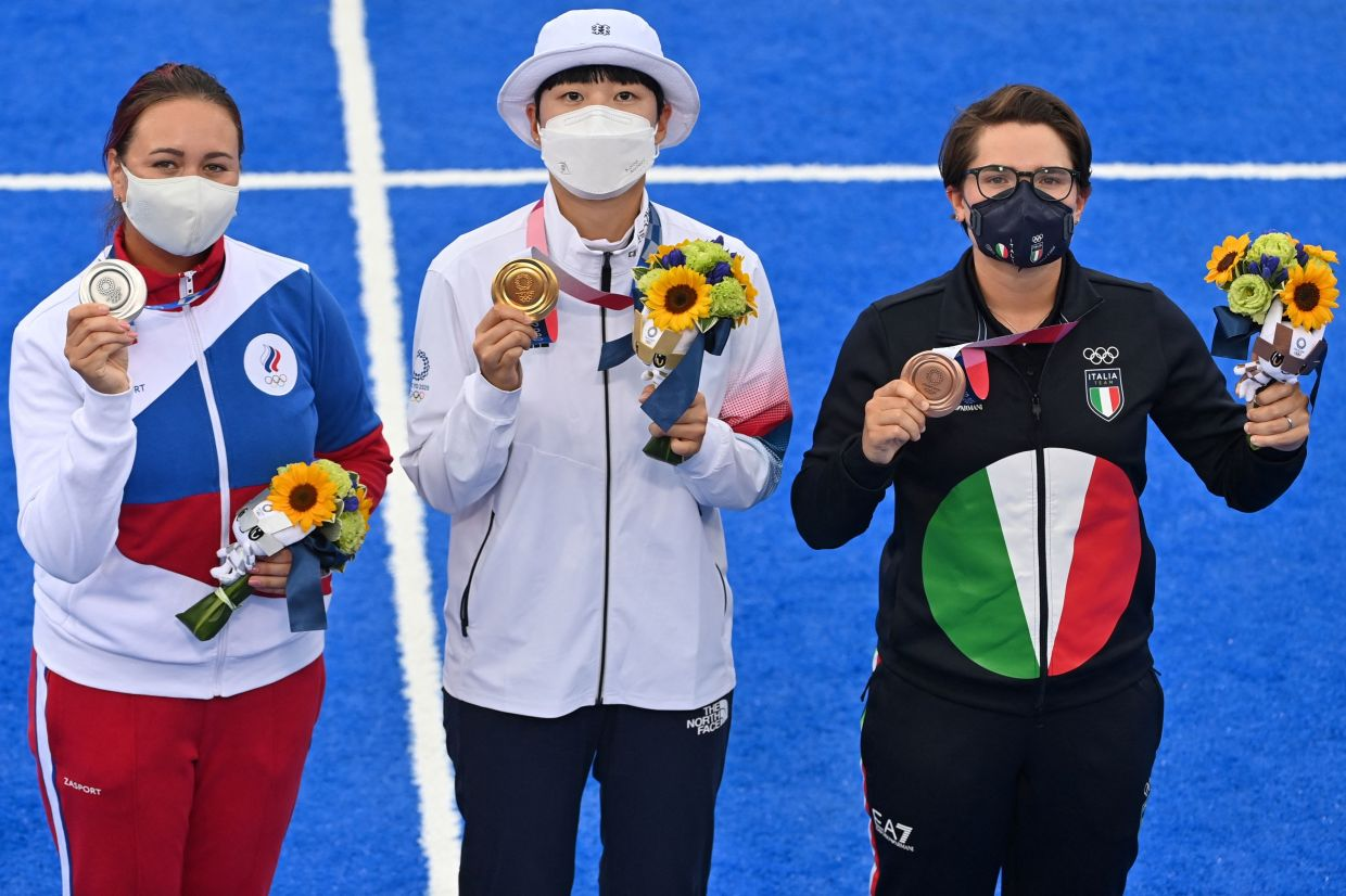 Gold medallist An San (centre) with silver medallist Russia's Elena Osipova (left)  and bronze medallist Italy's Lucilla Boari at women's individual victory ceremony. Photo: AFP