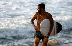 Olympics-Gold medal boosts pandemic-hit surf paradise in Brazil