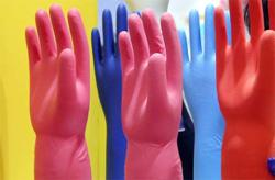Gloves top losers, weigh on KLCI