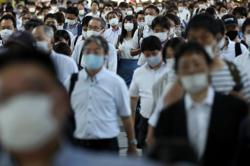 Top Japan medic urges nationwide state of emergency amid COVID surge