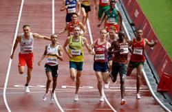 Olympics-Athletics-Kenya's Cheruiyot advances to 1,500m semis in quest for gold