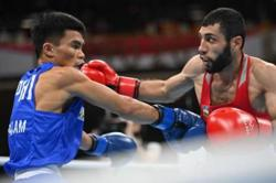 Philippine boxer Carlo Paalam ousts champ Zoirov, secures Olympic medal