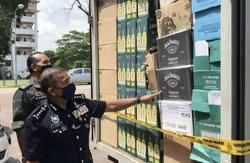 Cops foil illegal alcohol-processing ring, seize over RM3mil worth of booze