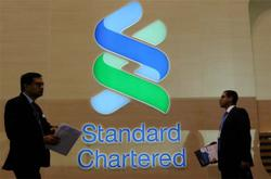 StanChart restores dividend, buyback but income drop signals challenges ahead