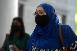 Housewife weeps in court after fined RM9,000 for insulting King