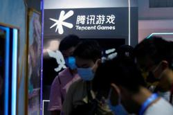 Tencent vows fresh gaming curbs after 'spiritual opium' attack zaps US$60bil