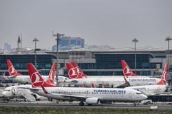 HK logs 4 imported virus cases, bans Turkish Airlines flights