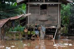 Houses, farmland inundated as rivers burst their banks in Laos