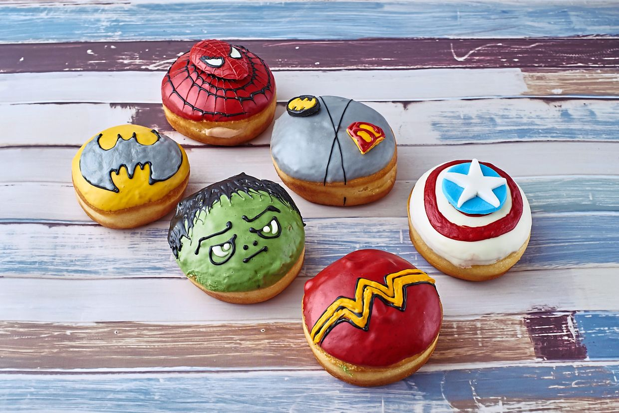 Doughnuts with comics-themed designs.