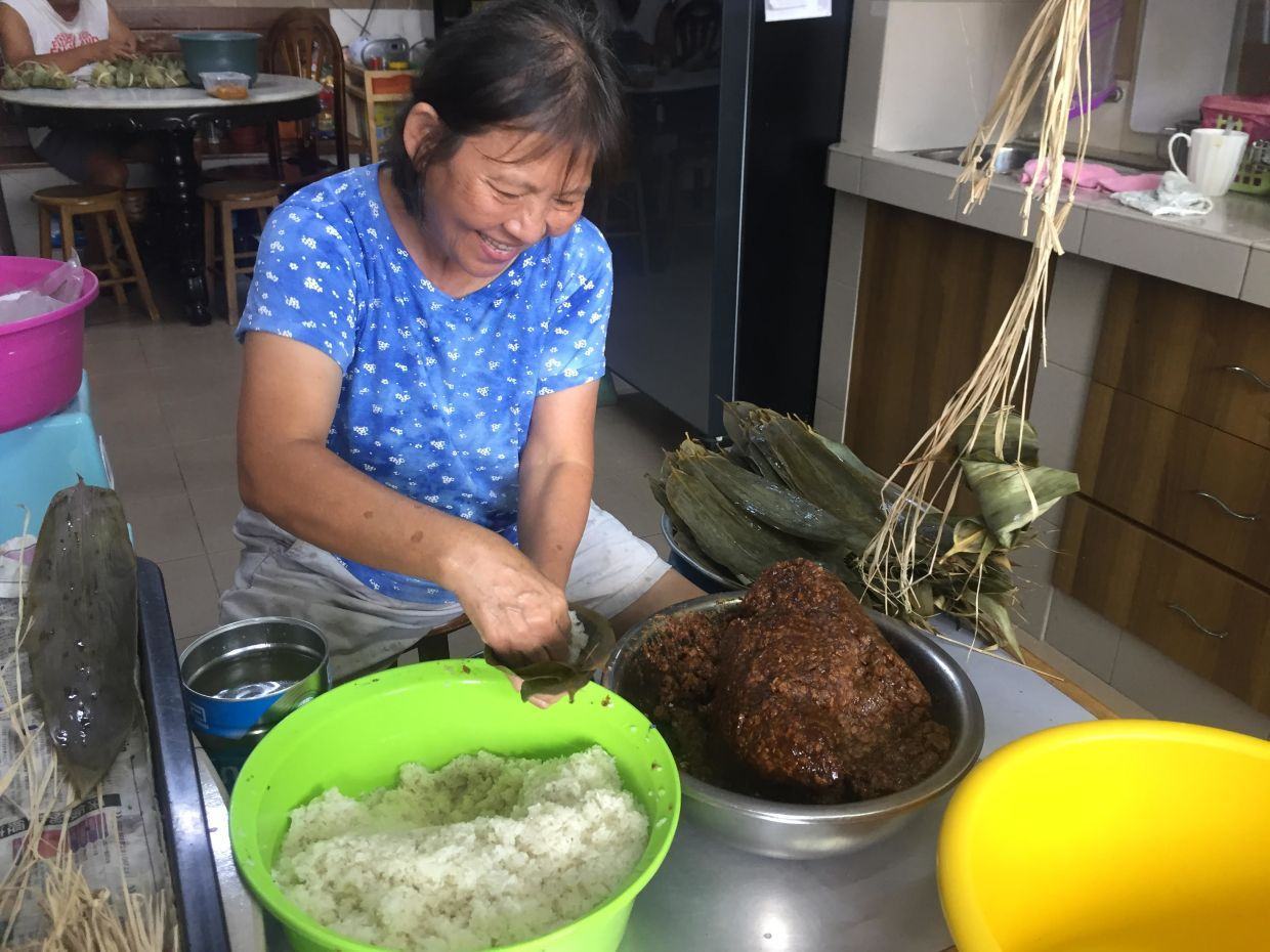 All the businesses under The Bendahari Markets are hand-picked by Chan to ensure authenticity. Pictured here is heritage bak chang maker Mrs Sim.