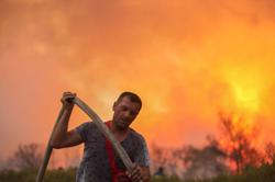 Athens suburbs brace for night inferno as blaze burns homes