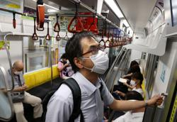 Tokyo doctor at the crossroads of a COVID-19 crisis and a quiet Olympics