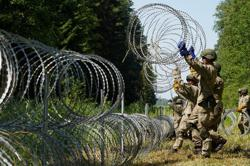 Lithuania denies Belarus reports of migrant death on border