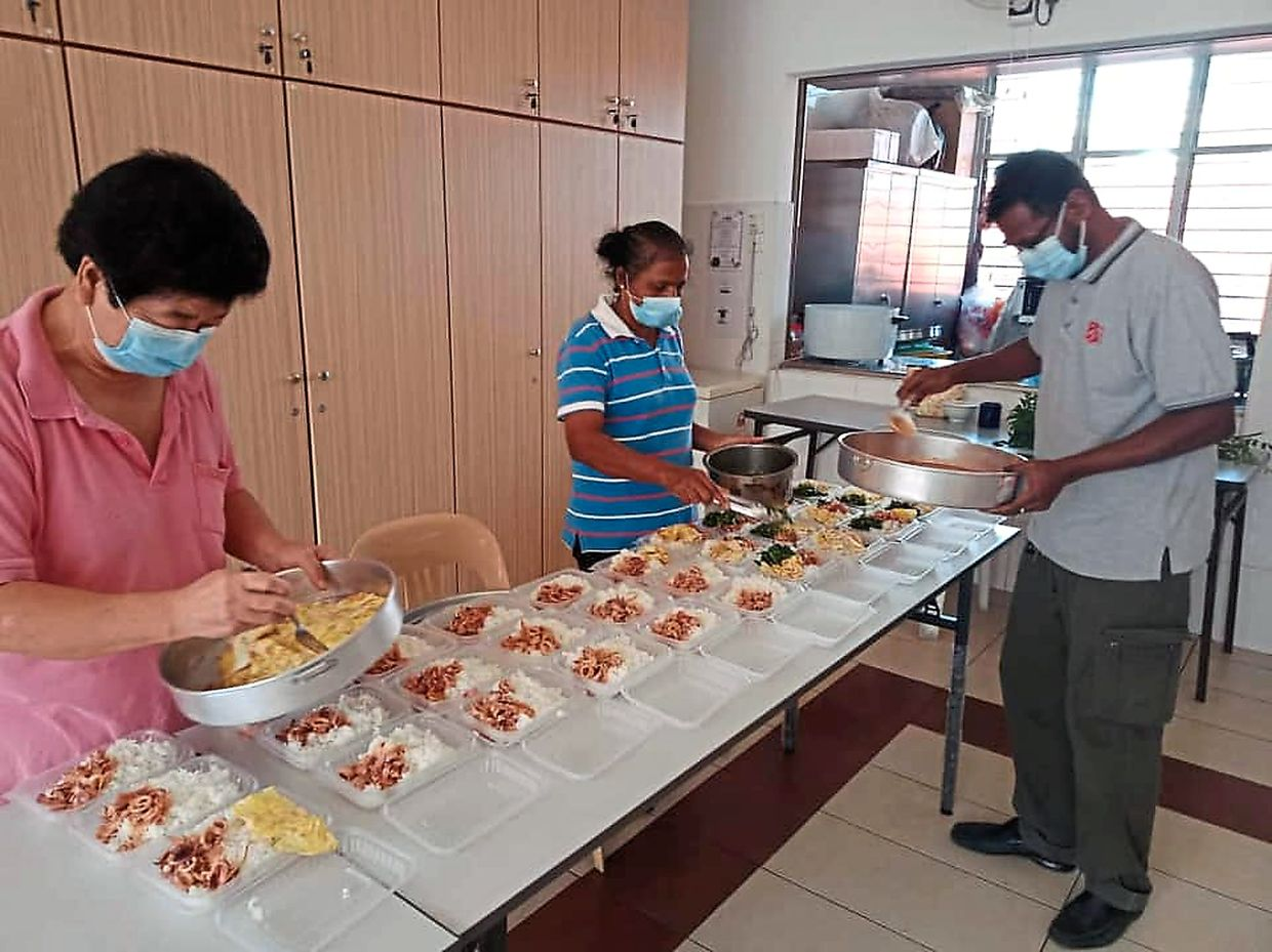The Salvation Army Melaka team making hot meals for communities in need.