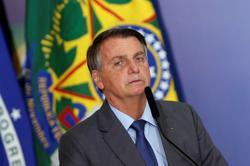 Brazil's Bolsonaro rages against probe, threatens to act beyond constitution