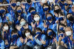 Pensioners defy virus fears, volunteer to keep Tokyo Olympics running