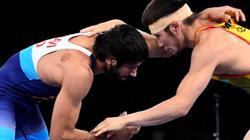Olympics-Wrestling- Governing body says Kazakh athlete's bite