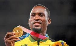 Parchment edges world champ Holloway in 110m hurdles