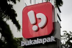 Bukalapak, Indonesia's biggest IPO, up 25% in blockbuster debut