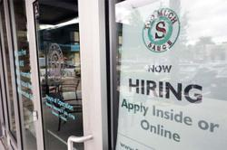 US labour market powers ahead with strong job gains, lower unemployment rate