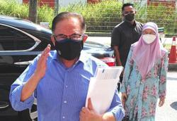 Anwar, Wan Azizah quizzed over rally