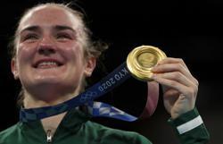 Olympics-Boxing-Harrington, Cruz win lightweight golds on final day in Tokyo