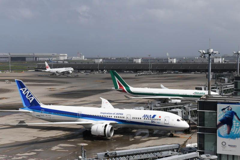 Aircraft operated by All Nippon Airways Co. (ANA) and Alitalia SpA at Haneda Airport in Tokyo, Japan, on Monday, Aug. 9, 2021. - Bloomberg