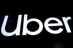 Uber launches service with taxi drivers in Colombia