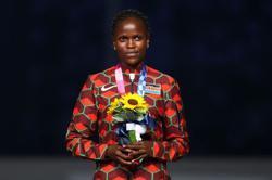 Athletics-Kosgei and Kitata to defend London marathon titles