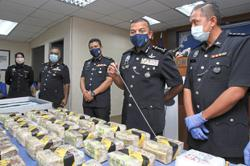 Cops seize drugs and vehicles worth RM1.7mil in three raids