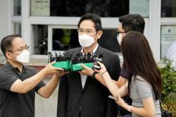 Samsung leader Lee Jae-yong released from prison on parole
