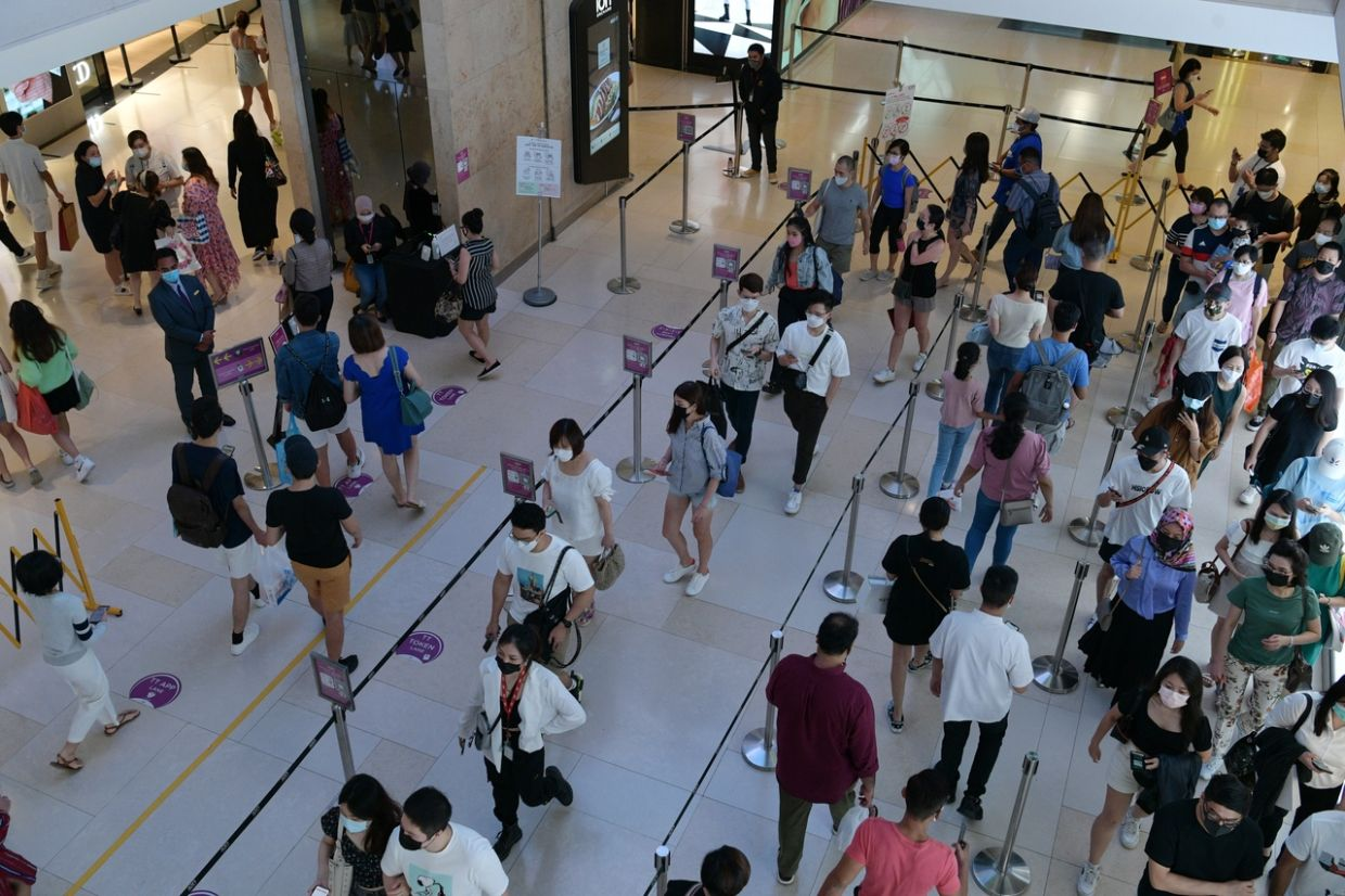 People queueing to enter Ion Orchard during lunchtime on Aug 14, 2021. - The Straits Times/ANN