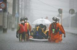 One dead, two missing as torrential rains slam Japan, risk alerts broadened