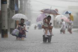 Heavy rain triggers floods, landslides in Japan; more than million urged to seek shelter