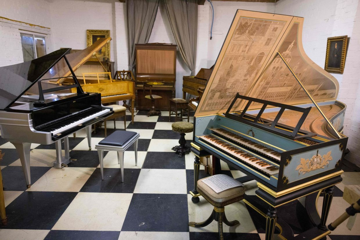 A selection of pianos are seen on display at royal piano restorer David Winston's workshop in Biddenden in south-east England. Photo: AFP