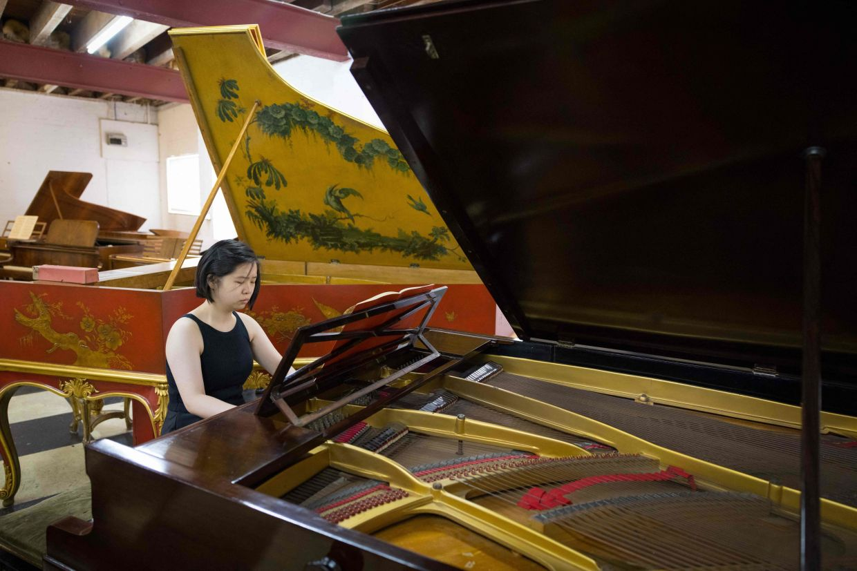 Pianist Xiaowen Shang plays a 1929 Pleyel double grand piano, made in Paris, formerly purchased for Madeliene Lioux Malraux, wife of the French novelist and politician Andre Malraux, at royal piano restorer David Winston's workshop. Photo: AFP