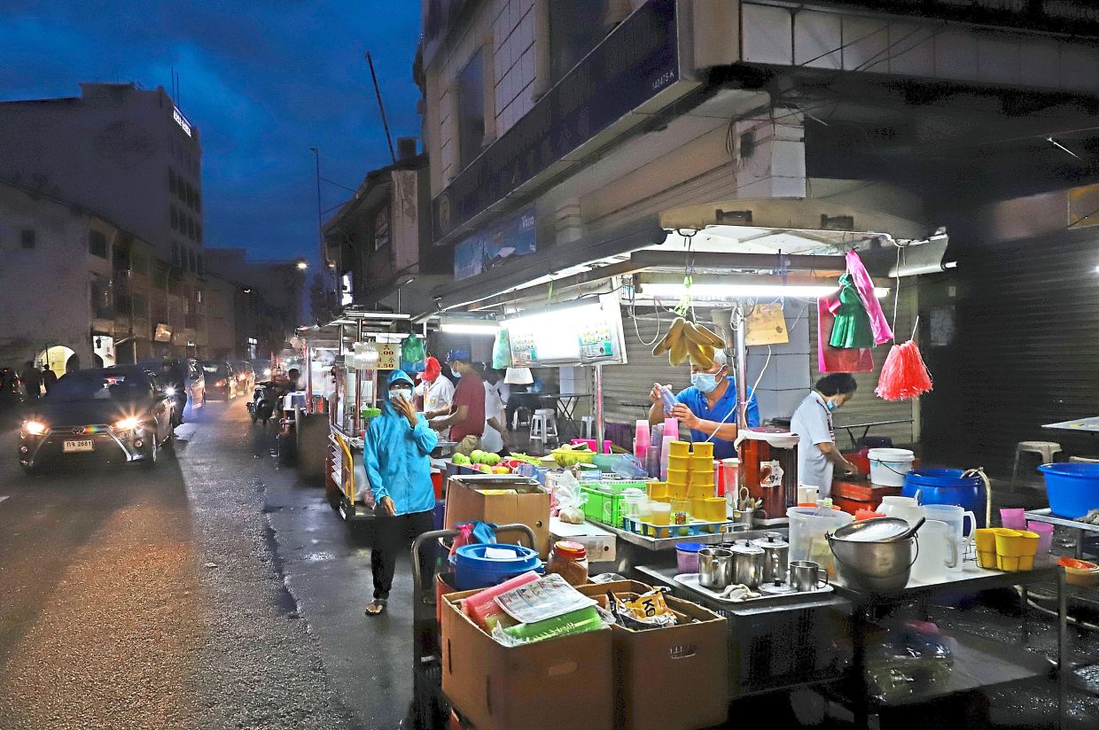 Hawkers selling food at roadside stalls in Chulia Street in George Town. — Filepic