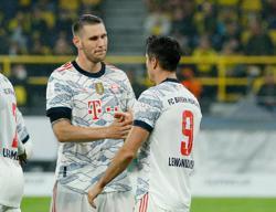 Soccer-Lewandowski double downs Dortmund as Bayern Munich win Super Cup