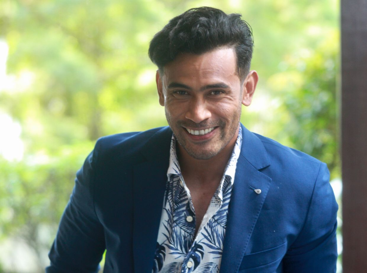 It's a happy day for Remy Ishak. Photo: Norafifi Ehsan/The Star