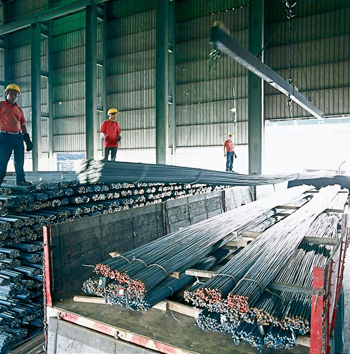 Manufactured steel rods being loaded to a lorry at Malaysia Steel Works plant in Bukit Rajah in Klang.