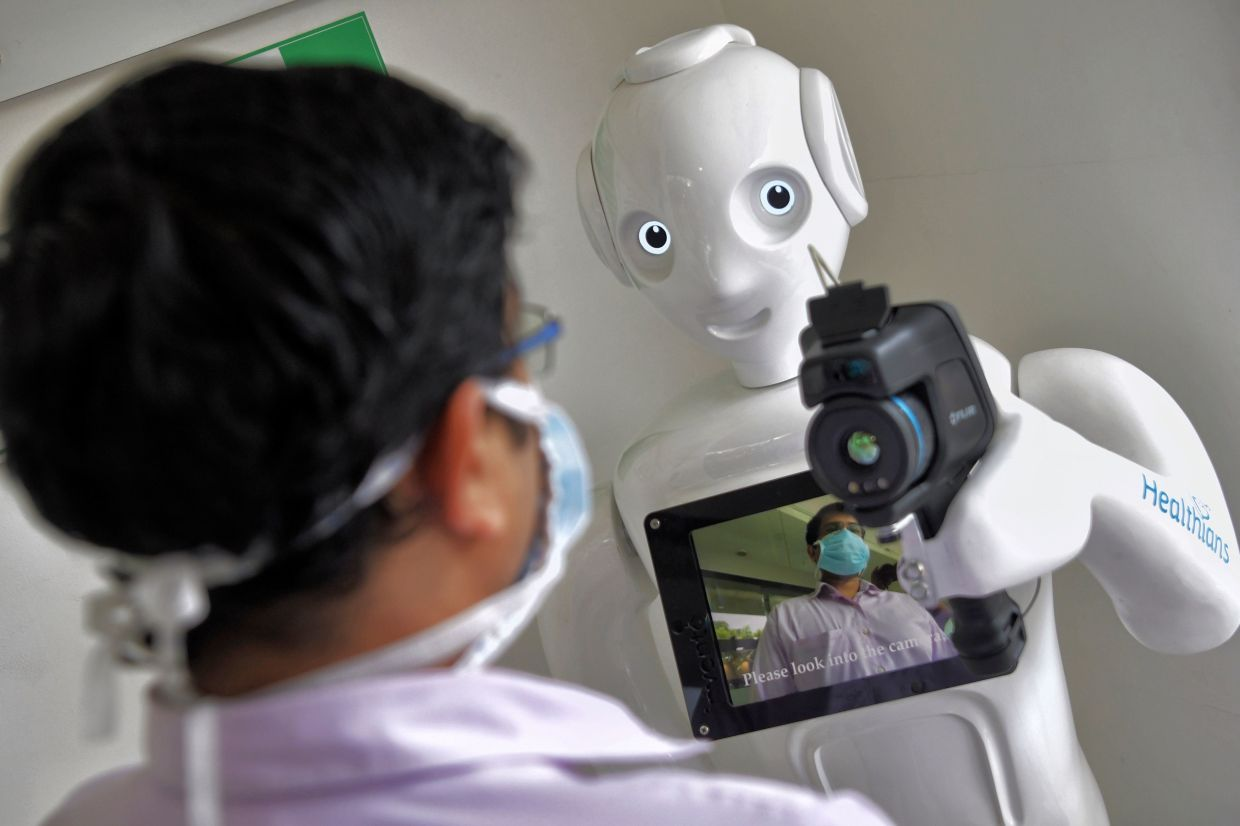 Mitra is a 5ft tall robot that can assist with preliminary screenings. — AFP