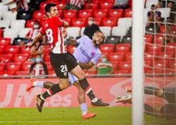 Soccer-Depay thunderbolt earns Barca point at Athletic Bilbao
